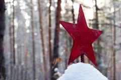 In the forest in the old forgotten cemetery the Soviet Army Red Army soldier is buried on the gravestone red star. In the forest in the old forgotten cemetery royalty free stock photo