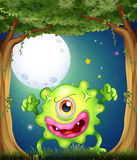 A forest with a one-eyed green monster. Illustration of a forest with a one-eyed green monster Stock Photography