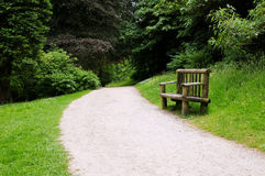 Forest Path. Forest Footpath and Wooden Bench Royalty Free Stock Photography