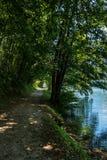 Lake of Levico Terme - Trentino Italy. Forest path along the coast of the lake of Levico Terme Lago di Levico in Valsugana, Trentino Alto Adige, northern Italy stock photo