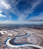 Forest of plain and small river in winter Stock Photography