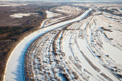 Forest of plain and small river in winter Stock Photo