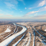Forest of plain and small river in winter Stock Photos