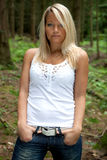 Forest portrait. Portrait of a young woman how is posing in the forest Royalty Free Stock Image