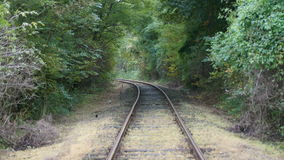 Forest railway in autumn. Hidden forest railway in autumn Stock Photo