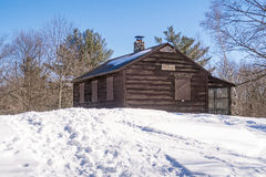 Forest ranger cabin in winter snow. On blue sky day, upstate rural New York, Beebe Hill State Forest summit Royalty Free Stock Image