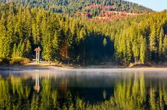 Forest reflection on foggy surface of Synevyr lake. National Park Synevyr, Ukraine - October 23, 2016: forest reflection on foggy surface of Synevyr lake. high Stock Photo
