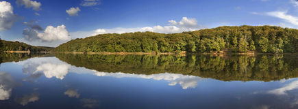Forest reflection panorama on beautiful Buyuk Bend lake Stock Images