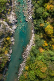 Canyon river. Birds eye view of canyon river surrounded with autumn trees Royalty Free Stock Images