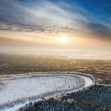 Forest river during cold winter morning, top view stock photo