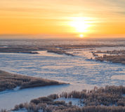 Forest river during cold winter sundown, top view Royalty Free Stock Photos