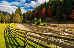 Forest river near the road and camping place. Beautiful mountainous landscape on fine autumn day Stock Photos