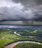 Forest river and rain clouds Royalty Free Stock Photo