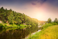 Forest river at sunset Stock Photo