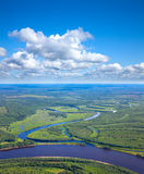 Forest river under white clouds Stock Photography