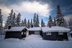 Forest scandinavian cabin in snowy woodland. Winter in Norway stock image