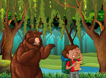 Forest scene with hiker and bear Royalty Free Stock Image