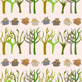Forest seamless pattern with cute owls Royalty Free Stock Image