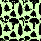 Forest seamless pattern with silhouette trees for your design. Black and green background Royalty Free Stock Image