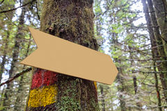 Forest sign in the form of an arrow with trail sign in red and yellow Royalty Free Stock Photography