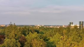 Forest skyline with view on apeldoorn city, popular Dutch town, The netherlands. A forest skyline with view on apeldoorn city, popular Dutch town, The stock footage