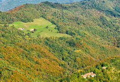 Forest and small villages on hills in fall Royalty Free Stock Images