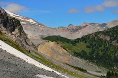 Forest, snow and rocks  in Mount Rainier National Park Stock Photo