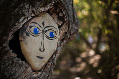 Forest spirit depicted on the stone watching trees. Forest spirit on depicted the stone watching watching Forest dwellers Royalty Free Stock Photos