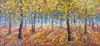 Forest strewn with yellow leaves. Trees in Fall. Original oil painting forest strewn with yellow leaves. Trees in Fall on canvas. Impasto artwork. Impressionism Royalty Free Stock Images