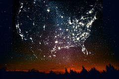 Landscape USA map constellations of city lights. Forest sunset landscape with projection of USA map in the form of stars of the constellations of city lights stock photography