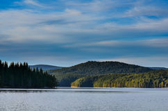 Forest surrounding an artificial lake, Rhodope Mountains, Bulgaria royalty free stock photo