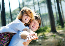 Forest trees couple fun Royalty Free Stock Photos