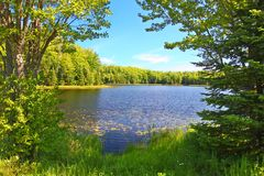 Mabel Lake Northwoods Wisconsin. Forest trees frame a scenic view of Mabel Lake in the Northern Highland American Legion State Forest of Wisconsin stock images
