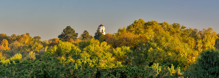 Forest of trees in full fall colors and Boise train depo. Train depot in Boise Idaho and autumn trees Stock Image