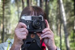 A woman takes pictures of the surrounding landscape. stock image