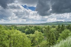 Forest under the dark clouds view from the top of the hill Stock Photography
