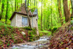 Forest Water House. Picturesque picture of a Water House in an enchanted green forest in Bavaria. Shot in Germany in spring in a rainy forest Stock Photos