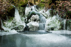 Forest waterfall. Retirement with icicles and forest waterfall Royalty Free Stock Photography