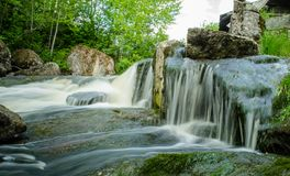 Forest waterfalls on the ruined mill royalty free stock photos
