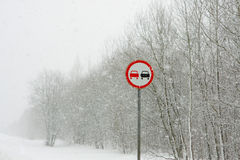 Forest in winter and traffic sign Stock Image