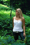 Forest woman. Young blond haired woman is posing in the forest Royalty Free Stock Images