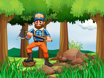 A forest with a woodman holding an axe Stock Photo