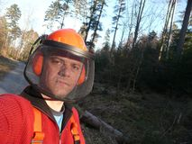 Forest worker 1. Lumberjack - forest worker withn helmet and ear protectors Stock Photo
