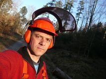 Forest worker. Lumberjack - forest worker withn helmet and ear protectors Stock Photo