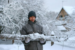 Forest worker with big hewed log stock images