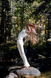 Forest Yoga Diva. Semi silhouette of Woman in yoga pose outdoors in the wods Royalty Free Stock Images