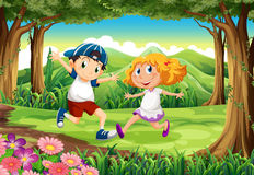 A forest with a young boy and girl Stock Photos