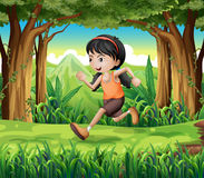 A forest with a young girl running Stock Photo