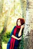 Foresta di autunno con la donna Immagini Stock