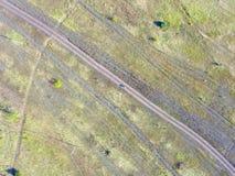 Foresta e campo con una fotografia aerea della traccia Fotografia Stock